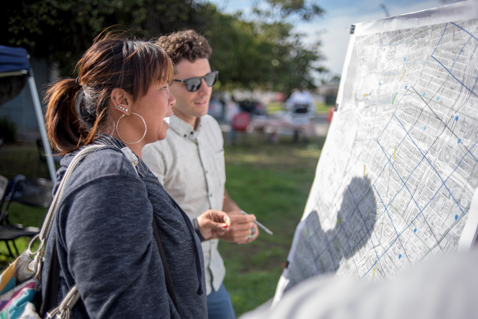 Image: people look at the proposed bike share routes. Photo: Pamela Palma Photography