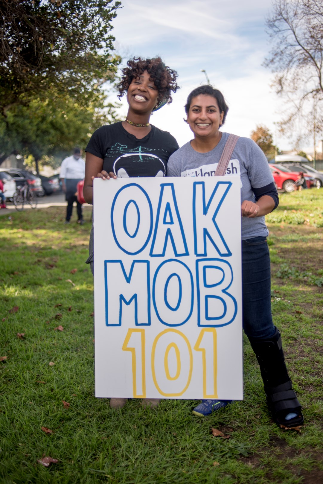 Image: Brytanee Brown and Anjali Mehta hold an OakMob101 sign. Photo: Pamela Palma Photography