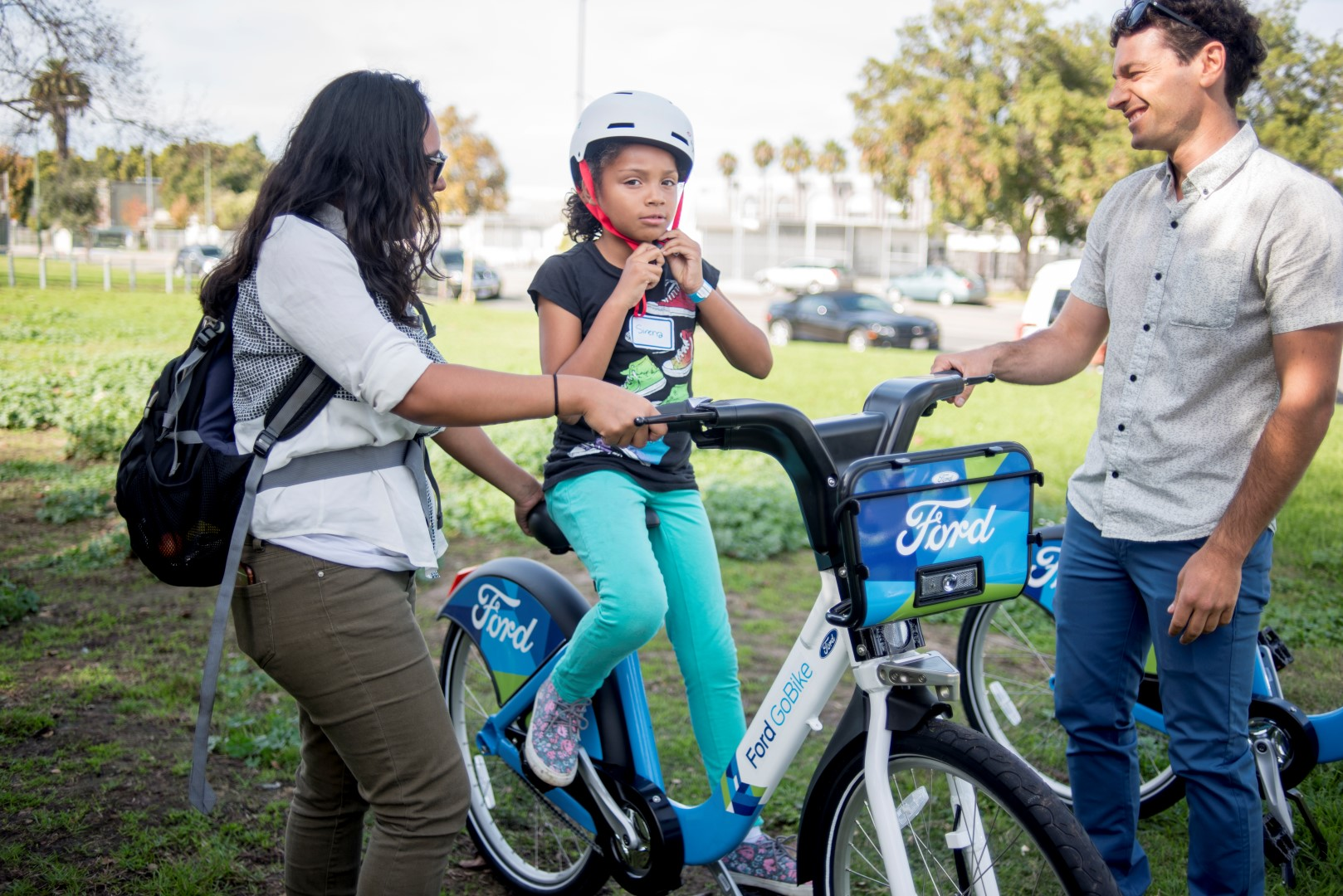 Image: a young girl tries out a Ford Go Bike. Photo: Pamela Palma Photography
