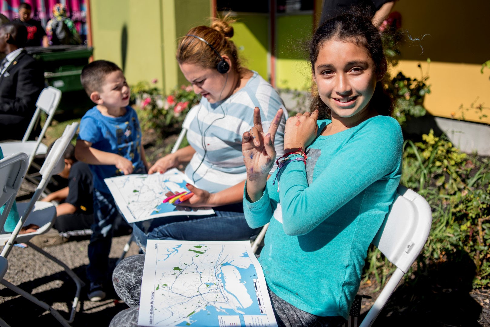 Image: a young girl draws her My Route Map. Photo: Pamela Palma Photography