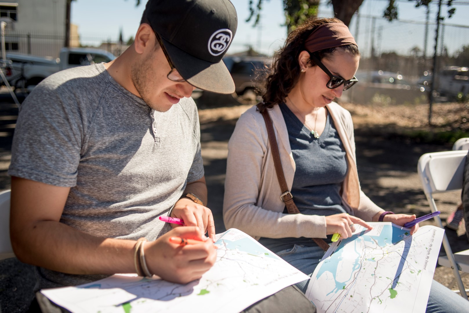 Image: a man and woman draw their My Route maps. Photo: Pamela Palma Photography