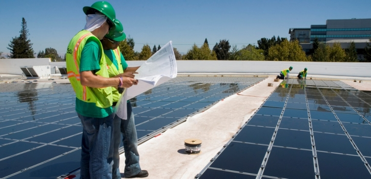 Installing solar panels on a building in California