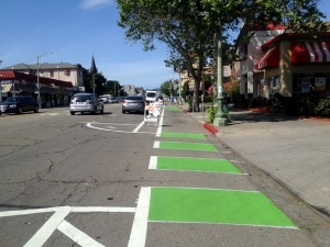 Photo of protected bike lane on Telegraph Ave. in Oakland; photo credit, Dianne Yee