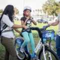 Image: a little girl uses a Ford GoBike. Photo: Pamela Palma Photography