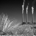 Image: three smokestacks in the California desert. Photo Flickr Nathan Rupert