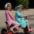 Two girls ride a bicycle. Flickr something.from.nancy