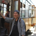 Image: an elderly woman boards Muni. Photo: Marta Lindsey
