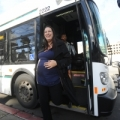 Image: a woman steps off an AC Transit bus. Photo: Noah Berger