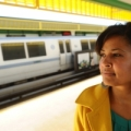 Image: a woman waits for BART at Fruitvale station. Photo: Noah Berger