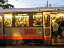 Crowded Muni car, by torbakhopper via Flickr