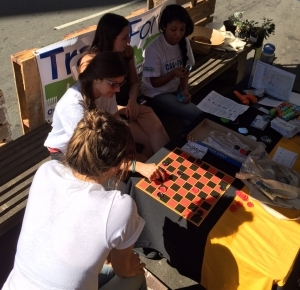 Playing checkers at the parklet