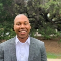 headshot of Jamario Jackson, the Senior Community Planner for the Disrupting Inequity team