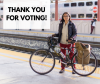 "Cyclist in front of a Caltrain train with the text: ""Thank you for voting!"""