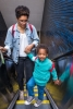 Image: a young woman and a little boy on the BART elevator at 19th St station, Oakland. Photo: Frederica Armstrong.